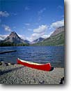 Stock photo. Caption: Two Medicine Lake   and Mt. Sinopah Glacier National Park Rocky Mountains,  Montana -- united states america landscape landscapes adventure mountains rockies leisure canoe canoeing boat boating lakes canoes outdoor recreation water sport sports independence freedom travel rowboats