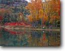 Stock photo. Caption: Bikers reflected in pond White Mountain National Forest New Hampshire New England -- united states america landscape landscapes adventure mountains outdoor recreation bicycle bicycles bikes autumn fall color refections people