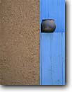 Stock photo. Caption: Adobe wall, turquoise door   and pottery Taos Pueblo New Mexico -- indian pueblo united states america native american archeology ancient civilization civilizations  architecture site archeologic sites spiritual pueblos artistic nature crafts craft