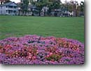Stock photo. Caption: Town Square in Thousand Island Park Wellesley Island,  Thousand Islands Saint Lawrence River Jefferson County,  New York -- americana nostalgic nostalgia united states america building buildings house houses parks flower flowers  district districts squares lawn lawns grass grass sundial sundials small town towns