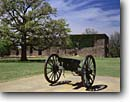 Stock photo. Caption: Cannon, oak and West Barracks (1856) Fort Washita Historic Site   near Durant Bryan County,  Oklahoma -- historical scenic destination destinations attractions spring tourist attraction southern scenics parks south heritage civil cannons cannon american artillery union confederate history west western sites indian wars forts safety safe cannonball parks