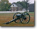 Stock photo. Caption: Cannons and G. Weikert House Cemetery Ridge Gettysburg National Military Park Pennsylvania -- cannon cannons wheel wheels civil war wars battlefield battlefields united states america tourist travel attraction attractions fall autumn  historic historical building buildings parks munitions weapon weapons