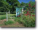 Stock photo. Caption: Garden outhouse Bolivar Peninsula Galveston County Texas -- united states america outhouses toilet toilets latrine symbol western rest room john privy head rustic half moon