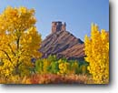 Stock photo. Caption: Fremont cottonwoods frame Priest and Nuns on Castle Rock Colorado Riverway Colorado Plateau, Utah -- canyon sandstone landscape landscapes tourist travel destination destinations scene scenic geology formation formations geologic rocks rivers clear sunny calm patience landmarks landmarks named climbing spectacular foliage colors color blue fall autumn
