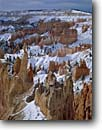 Stock photo. Caption: Winter sunrise Bryce Ampitheater Bryce Canyon National Park Colorado Plateau, Utah -- united states america sandstone parks red rock country landscape landscapes travel tourist destination destinations solitude tenacity plateaus spire spires hoodoo hoodoos snow snowfall canyons winter storm fresh wintery Paunsaugunt
