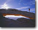 Stock photo. Caption: Mesa Arch Island in the Sky Canyonlands National Park Colorado Plateau,  Utah -- united states america rock formation formations canyons landscape red rock country sunrise landscapes sandstone arches window windows parks people crossing walking across hiking distance strength enduring view vista scenic sunburst trust faith dramatic