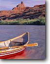 Stock photo. Caption: Dory and Mexican Hat Rock San Juan River Navajo Indian Reservation Colorado Plateau,  Utah -- boating dories trip trips southwest southwestern united states america balanced rock rocks plateaus rivers canyon canyons spring desert deserts country rafting geology formation formations geologic geological paddle paddles