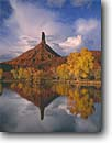 Stock photo. Caption: Castle Rock reflection Castle Valley Colorado Plateau Utah -- united states america  southwest canyon country red rock spires spires reflections fall color autumn cottonwood clouds point pointy