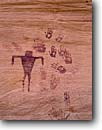 Stock photo. Caption: Pictograph & handprints Sheiks Canyon,  Cedar Mesa Canyonlands National Park Colorado Plateau,  Utah -- Anthropomorphic petroglyph native american rock art parks united states america ancient civilization civilizations indian indians hand print historic historical mystical petroglyphs design designs spiritual anasazi culture pictographs red rock country