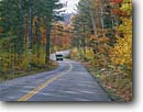 Stock photo. Caption: Groton-Marshfield State Highway Groton State Forest Caledonia County Vermont -- road hardwood forests fall autumn cloudy highways roads trees scenic curve curves drive drives windy  curvey backroad backroads northeast northeastern vehicle recreational camper truck roadway tourist destinations travel traveling trip family vacation