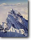 Stock photo. Caption: Aerial of Mt. Terror and Mts. Baker   and Shuksan,  Southern Pickets North Cascades National Park North Cascade Range, Washington -- winter united states america mountain mountains glaciers northwest northwestern pacific state landscape landscapes peaks parks rock rocky  alpine scenic wilderness wildernesses dramatic views view volcanic cones from airplane airplanes cold striking