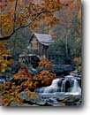 Stock photo. Caption: Glade Creek Grist Mill Babcock State Park   Allegheny Mountains West Virginia -- parks fall autumn waterfall waterfalls color colors leaves trees branches quaint nostalgia nostalgic mills historic historical buildings cascade cascades maples maple sugar united states america rural grinding americana tourist attraction attractions