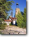 Stock photo. Caption: Old Baileys Harbor Light Lake Michigan Door County Wisconsin -- Keywords: tourist destination destinations attraction attractions sunny blue quaint northern lighthouses station stations light calm clear tower lighthouse midwest midwestern historic historical great lakes