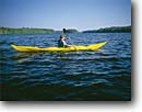 Stock photo. Caption: Kayaking on the Wisconsin River near Merrill Lincoln County Wisconsin -- Keywords: boat boats vessel vessels sunny blue northern kayak kayaker kayakers kayaks canoes canoe woman women boating paddle paddles rivers outdoor recreation  summer