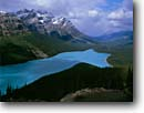 Stock photo. Caption: Rainbow over Peyto Lake Banff National Park Rocky Mountains Alberta, Canada -- aqua blue glacial silt lakes world heritage site sites parks mountain canadian rockies landscape landscapes tourist travel vacation destination destinations powder peak peaks rainbows storms stormy unsettled weather