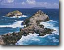 Stock photo. Caption: Pointes des Colibris,  La Roche,  and La Desirade Point, Des Chateaux Grande Terre,   Guadeloupe Lesser Antilles,  France -- crashing wave waves surf caribbean  island tropical destination point tropical destinations vacation vacations tourist travel seascape seascapes island islands seastack seastacks headland headlands overseas departments french