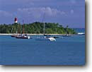 Stock photo. Caption: Islet du Gosier   from Gosier Grande Terre,   Guadeloupe Lesser Antilles,  France -- caribbean beach beaches lighthouse lighthouses sailboat sailboats tropical destination destinations vacation vacations tourist travel seascape seascapes island islands  french harbor anchorage harbors harbour harbours anchorages overseas departments