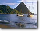 Stock photo. Caption: Soufriere Bay and Petit Piton Soufriere, Saint Lucia Windward Islands Lesser Antilles -- beach beaches peak peaks bays sailboat sailboats pleasure craft boats tranquil anchorage anchorages tropical destination destinations world caribbean sea seas tourist tourist travel seascape seascapes attraction attractions