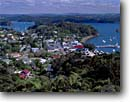Stock photo. Caption: Russel and Pomare Bay   from Flagstaff Hill Bay of Islands North Island, New Zealand --   shorelines morning summer travel destination destinations tourist seascape seascapes town towns village villages tourist quaint bays harbor harbors harbour harbours overlook overlooks attraction attractions