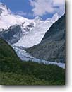 Stock photo. Caption: Fox Glacier, Mt. Haidinger  and Douglas Peak from Glacier Road Westland National Park, Southern Alps South Island, New Zealand -- international world travel mountain snow spring december traveler landscape landscapes destinations tourist glaciers glaciated glacial parks tongue tongues terminus creeks stream streams receding spring moraine moraines clear sunny scenic scenics islands