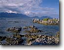 Stock photo. Caption: Seaward Kaikoura Range from Kaikoura Peninsula South Pacific Ocean South Island, New Zealand -- points bays tidepool tidepools  oceans seascape seascapes tourist travel international destination destinations ranges mountains rugged rocky shore shores shoreline shorelines tranquil calm peninsulas