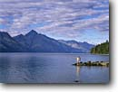 Stock photo. Caption: Lake Wakatipu Southern Alps South Island New Zealand -- hiker hiking landscape landscapes  lake lakes mountains southern hemisphere islands hikers travel destination destinations attraction attractions tourist people