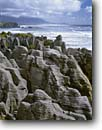 Stock photo. Caption: Pancake Rocks and Dolomite Point Paparoa National Park Tasman Sea South Island, New Zealand -- international travel tourist destination destinations attraction attractions holiday trip vacation coastal ocean surf sand waves wave seastacks headland headlands seascape seascapes world limestone points parks pounding crashing landmarks landmark