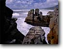 Stock photo. Caption: Pancake Rocks,  Dolomite Point Paparoa National Park Tasmanian Sea South Island,  New Zealand -- international travels tourist destination destinations attraction attractions holiday trip vacation coastal ocean beach surf sand waves wave seastacks headland headlands afternoon seascape seascapes world travel limestone points parks pounding crashing