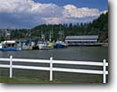 Stock photo. Caption: Lobster boats Vaughn Creek-Irish River Covered Bridge Saint Martins,  New Brunswick Maritime Provinces,  Canada -- tourist travel destination destinations port bridges commercial fishing boat vessel vessels fence fences harbor harbors harbour harbours port ports province canadian