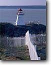 Stock photo. Caption: Point Endure Lighthouse Bay of Fundy New Brunswick Maritime Provinces,  Canada -- light lights station stations spring lighthouses canadian protection beacon beacons direction guidance pharos navigation navigational aid aids  fence fences bays building buildings white pickett picket
