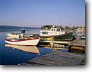 Stock photo. Caption: Baddeck Cape Breton Island Nova Scotia, Canada Maritime Provinces -- Keywords: seascape seascapes tourist destination destinations attraction attractions port commercial fishing boat boats vessel vessels harbor harbors harbour harbours town towns city historic canadian sunny blue buildings building quaint villages village northern