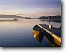 Stock photo. Caption: Baddeck Lighthouse at sunrise Baddeck Cape Breton Island Nova Scotia, Canada -- Keywords: seascape seascapes tourist destination destinations attraction attractions port boat boats vessel vessels harbor harbors harbour harbours sunny blue  quaint canadian northern lighthouses station stations light calm clear wooden canoe canoes docks
