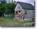 Stock photo. Caption: Pleasant Bayfolk art Cape Breton Island Nova Scotia Maritime Provinces, Canada -- Keywords: seascape seascapes tourist destination destinations attraction attractions port town towns historic canadian buildings building quaint villages village northern carvings nostalgia gifts gift store