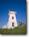 Stock photo. Caption: North Rustico Harbor Lighthouse Prince Edward Island Maritime Provinces Canada -- Keywords: tourist destination destinations attraction attractions sunny blue quaint canadian northern lighthouses station stations light calm clear pots lobster fishing lights islands province white