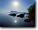 Stock photo. Caption: Pic Island from Flathead Island   south of Thunder Bay Lake Superior Ontario,  Canada -- canadian dawn bay calm tranquil great lakes bays reflection reflections sun flare rays god ray peaceful peace spiritual summer blue sky skies sunny clear clean islands