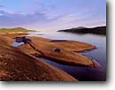 Stock photo. Caption: Foster Island   with Pic Island in background Lake Superior west of Marathon Ontario,  Canada -- Keywords: canadian dawn bay calm  tranquil great lakes bays polished rock glacial glaciated inlet inlets calm rocky shoreline shorelines lakeshore summer landscape landscapes lakeshores scenic scene islands
