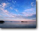 Stock photo. Caption: Looking northeast   from near Mink Island Lake Superior Ontario,  Canada -- Keywords: canadian dawn bay calm clouds great lakes skies summer calm shoreline shorelines lakeshore summer landscape landscapes lakeshores scenic scene islands   clouds cloudy