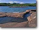 Stock photo. Caption: Foster Island     west of Marathon Lake Superior Ontario, Canada -- glacial polished shield canadian lakeshore lakeshores rocky shore shoreline bays lakes parks north america summer great rock islands landscape landscapes scenic scene sunny clear sky skies clear