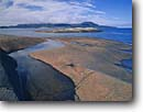 Stock photo. Caption: Foster and Pic Islands in Lake Superior   near Neys Provincial Park Ten miles west of Marathon Ontario,  Canada -- Keywords: glacial polished shield canadian lakeshore lakeshores rocky shore shoreline bays lakes parks north america summer great rock islands landscape landscapes scenic scene sunny clear sky skies clear