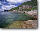 Stock photo. Caption: Southeast tip of Pic Island   in Lake Superior Ten miles west of Marathon Ontario,  Canada -- Keywords: headland headlands clear water pure canadian summer great lakes tranquil solitude landscape landscapes clarity shoreline lakeshore lakeshores rocky rock islands rugged shorelines  clean waters
