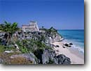 Stock photo. Caption: Great Pyramid of Tulum   on Caribbean Coast Quintana Roo  Yucatan, Mexico -- Keywords: castle native american ruin ruins temple temples mayan beach beaches tropical tourist world central america attraction attractions landscape landscapes buildings building sandy  archeology archeological latin american landscape landscapes sunny clear blue