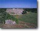 Stock photo. Caption: Mayan ruins at Ake   southeast of Tixcocab Yucatan Mexico -- Keywords: native american ruin temple temples tropical tourist destination destinations central america attraction attractions landscape landscapes pillars ancient mysterious building buildings archeological archeologic history past civilizations latin scenics