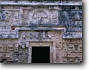Stock photo. Caption: Mayan ruins from the Classic Period Doorway to Nunnery Annex Chichen Itza near Piste Yucatan,  Mexico -- Keywords: international travel travels traveling Mexican north america ancient history historical tropical vacation spot vacations ruin temple  winter december national park persistance strength tourist building buildings archeological ornate door doors stone latin