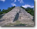 Stock photo. Caption: Mayan ruins from the Classic Period Pyramid of Coba,  Northwest of Tulum Quintana Roo Yucatan,  Mexico -- Keywords: international travel travels traveling Mexican north america ancient history historical tropical vacation vacations ruin temple winter december national park persistance strength tourist building buildings stone pyramids archeological sunny blue latin