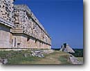 Stock photo. Caption: Mayan ruins at Uxmal south of Muna Palace of the Governor with pyramid   of the Magician in distance Yucatan,  Mexico -- temple temples ruin pyramids native american tropical destination destinations world central america tourist travel landscape landscapes attraction attractions vacations precolumbian columbian building buildings summer stone blue skies latin sunny clear