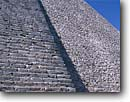 Stock photo. Caption: Pyramid of the Magician Mayan Ruins of the Classic Period Uxmal south of Muna Yucatan,  Mexico -- temple temples ruin pyramids native american tropical destination destinations world central america tourist travel attraction attractions vacation vacations precolumbian  columbian building buildings summer stone detail details construction latin scenic