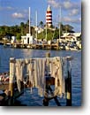 Stock photo. Caption: Elbow Cay Lighthouse Hope Town Harbor Elbow Cay Abaco, Bahamas -- marina marinas harbors harbour harbours net nets lighthouses station stations island islands tropical destination destinations tourist travel fishing tourist travel  attraction attractions stripped strips