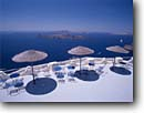 Stock photo. Caption: Terrace view of the volcanic island   Nea Kameni from Santorini (Thira)   in the Cyclades Greece -- international travel destination destinations vacation greek leisure blue color colour colours colors umbrellas umbrella aegean sea islands tropical luxurious luxury europe