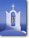 Stock photo. Caption: One of many churches in Fira   on Santorini Island   in the Cyclades Greece -- international travel destination destinations vacation greek aegean sea islands worship historic history religion religious cross crosses spiritual holy church churches places pure purity bell bells europe