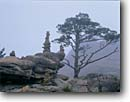 Stock photo. Caption: Stone offerings atop Kwongumsong Soraksan National Park near Sokcho    near the East Coast Republic of South Korea -- castle offering stacked stones balance balanced forest forests asia asian korean peninsula parks world travel tourist destination destinations mountain mountains summer landscape landscapes international religious sites site landscape landscapes